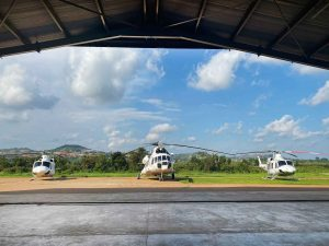 View of Bell 412EP and Mi8-MTV from Hangar